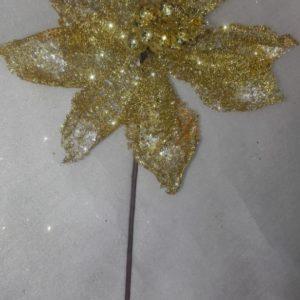 Flor poinsettia dorada escarchada