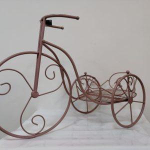 Pote triciclo rosado